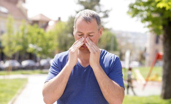 man with sinus pain