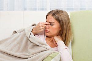 woman with a sinus headache