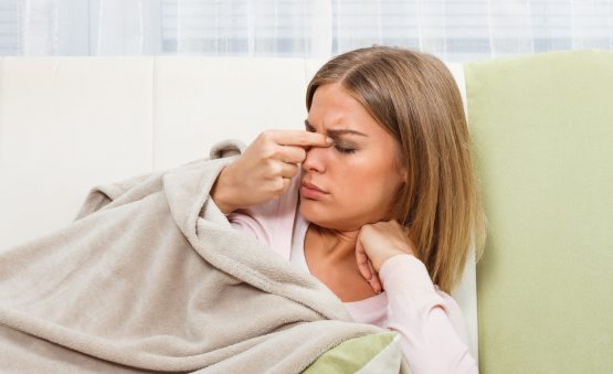 woman with a sinus headache